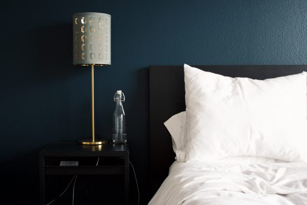 master bedroom with side lamp
